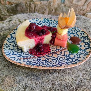 FRESH CHEESE ROASTED CAKE WITH RED FRUIT SAUCE